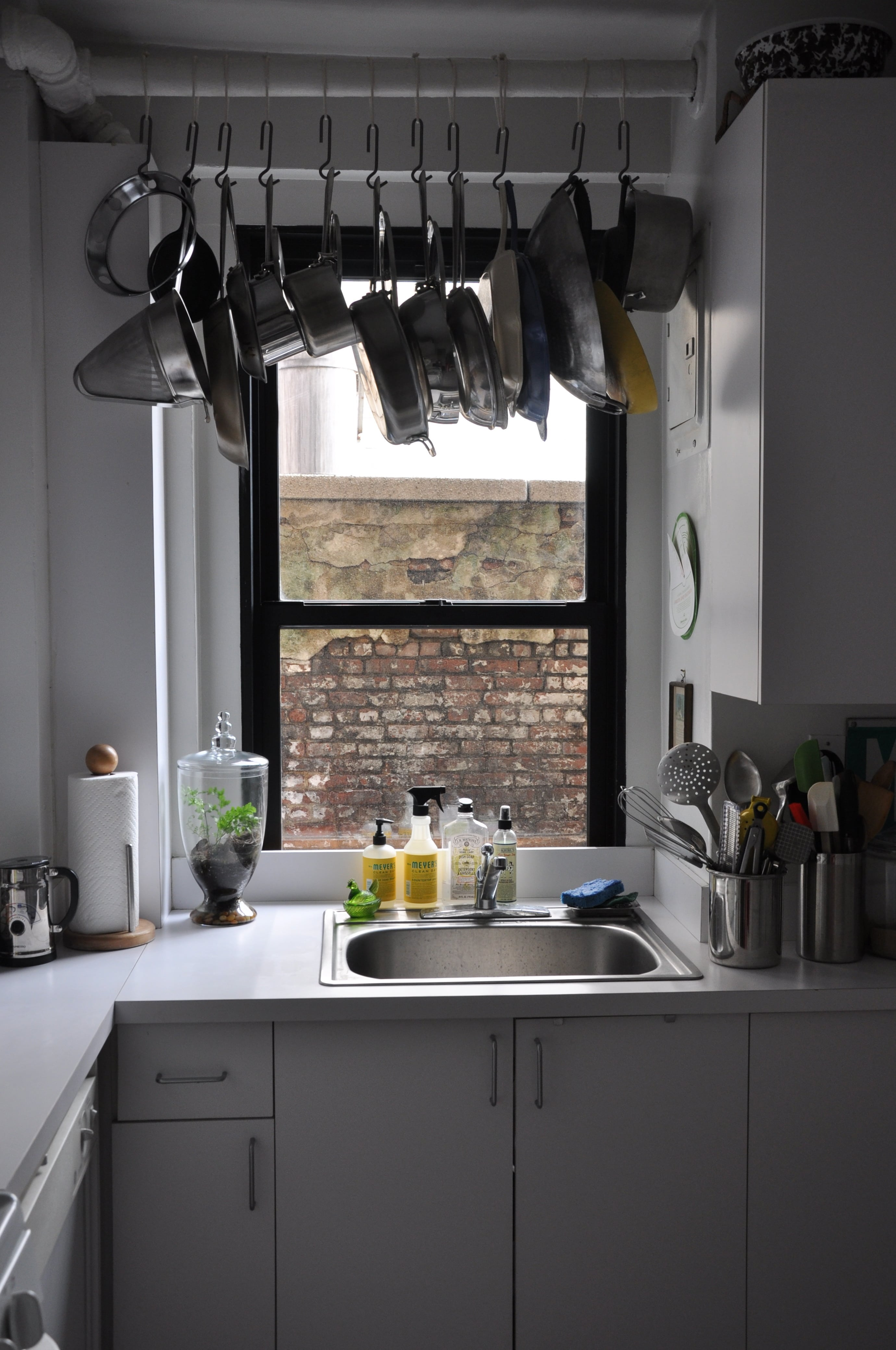 Hanging-pots-and-pans-creates-more-storage-space