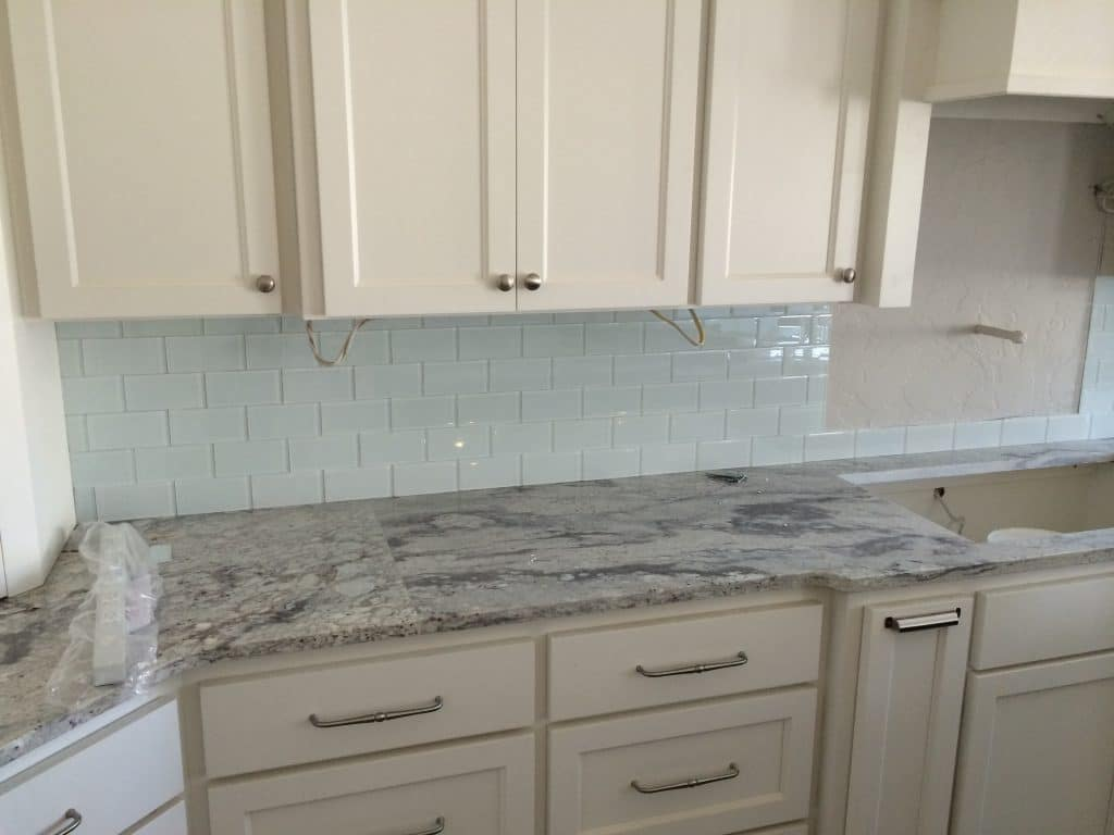 A-tiled-backsplash-in-a-neutral-kitchen-under-construction-kitchen-remodel